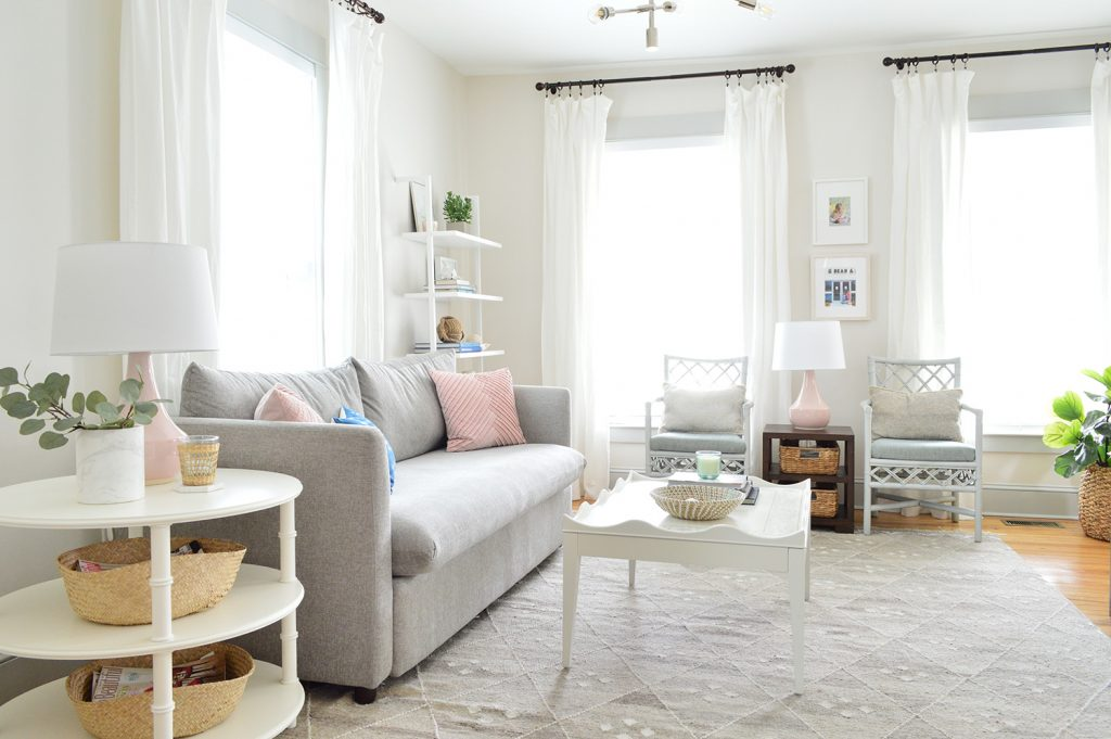 bright neutral living room gray sofa white heron walls