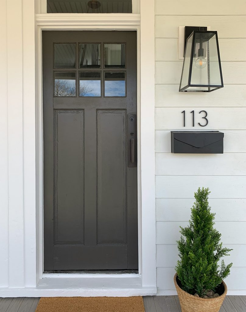 One Side Of Duplex Front Porch With Dark Door And Hardware