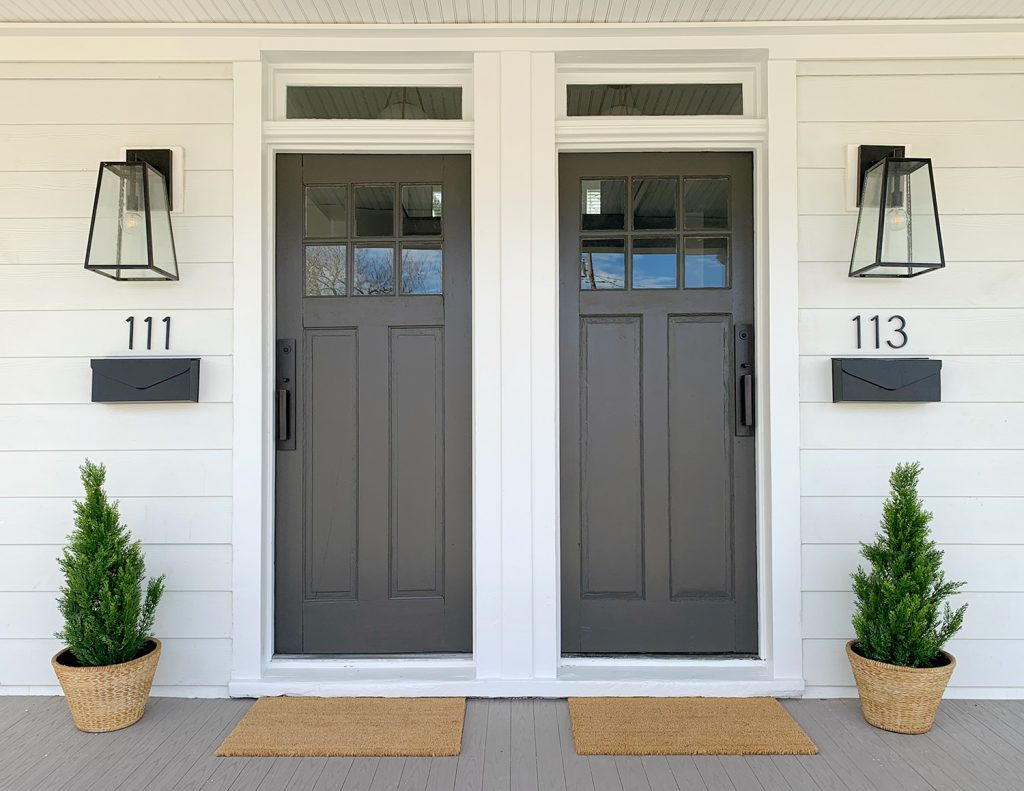 Duplex Front Porch With Matching Dark Gray Doors Plants House Numbers Mailboxes