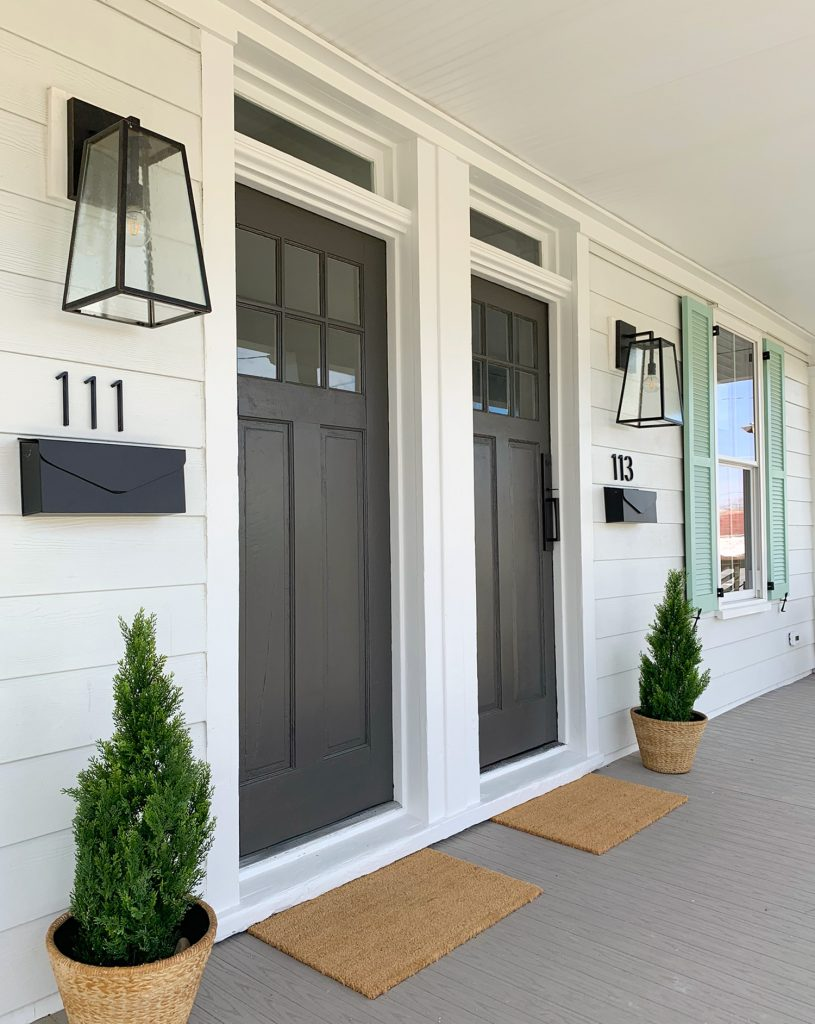 Duplex Front Porch From Angle With Oversized Black Lanterns And Matching Mailboxes