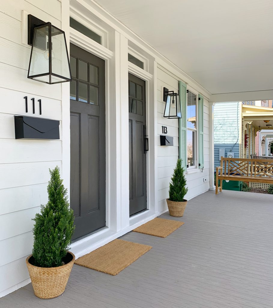 Duplex Front Porch With Matching Doors And Wood Bench