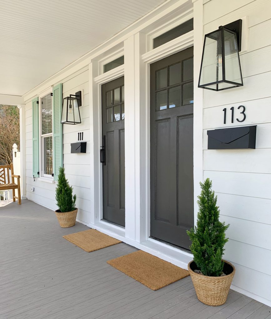 Duplex Front Porch From Angle With Doormats Planters And Benches In Similar Color