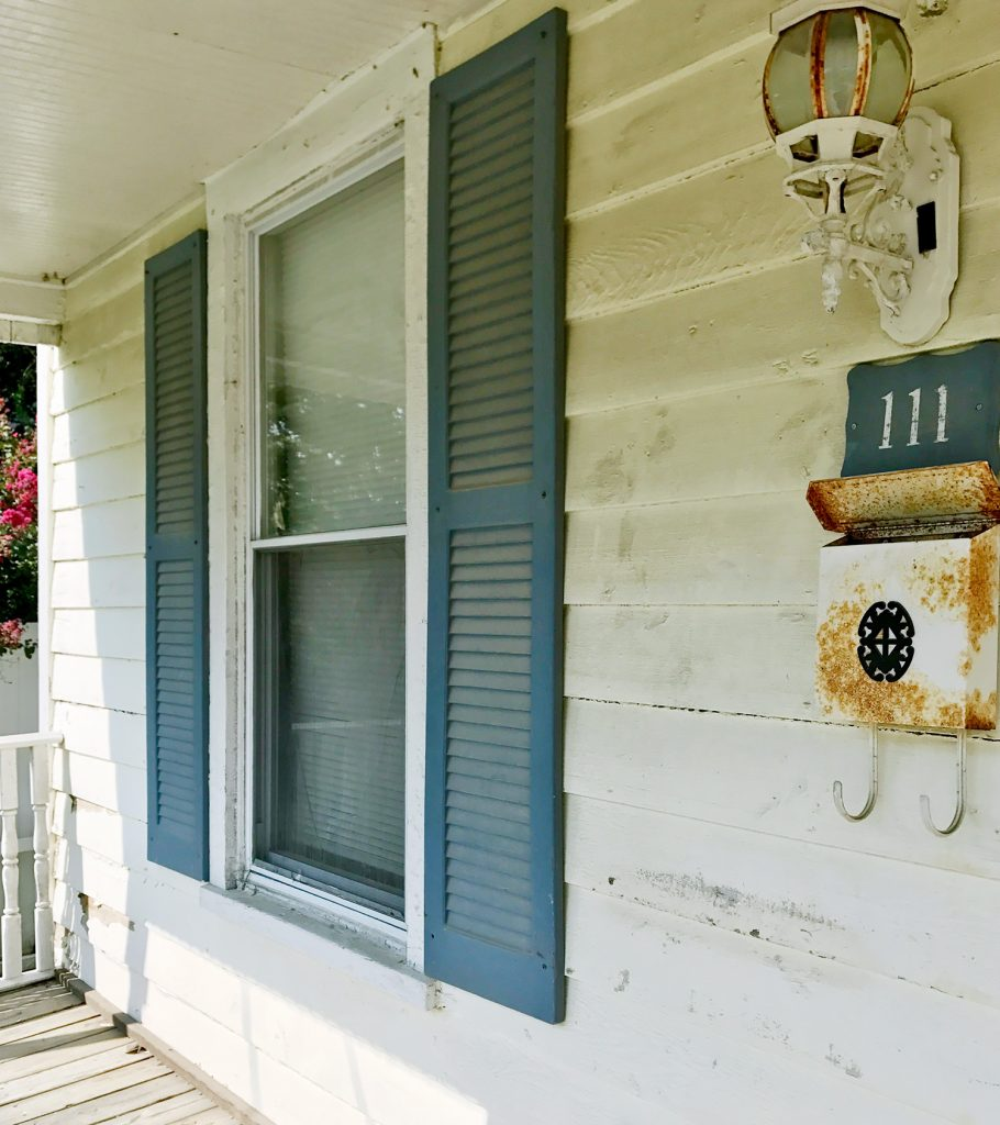 This image has an empty alt attribute; its file name is Duplex-Front-Porch-Before-111-Angle-910x1024.jpg