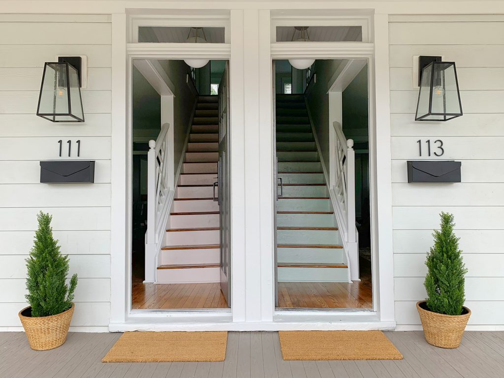 Duplex Colorful Staircases With One Painted Pink One Blue Green With House Numbers