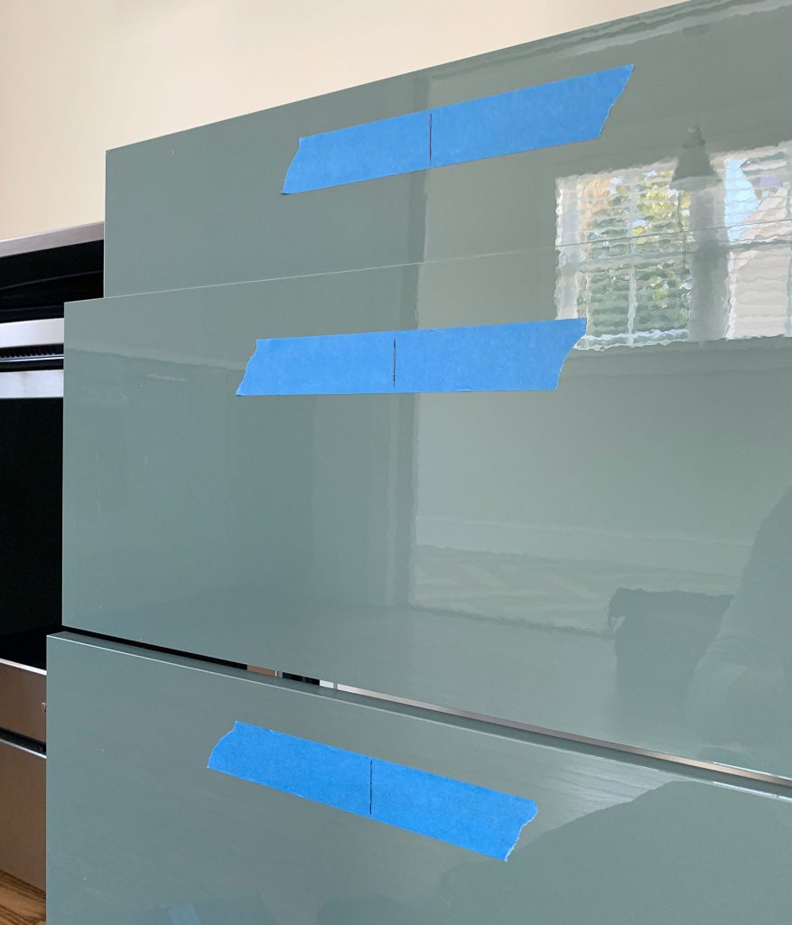 Center Lines Marked On Protective Tape On Kitchen Drawer Fronts