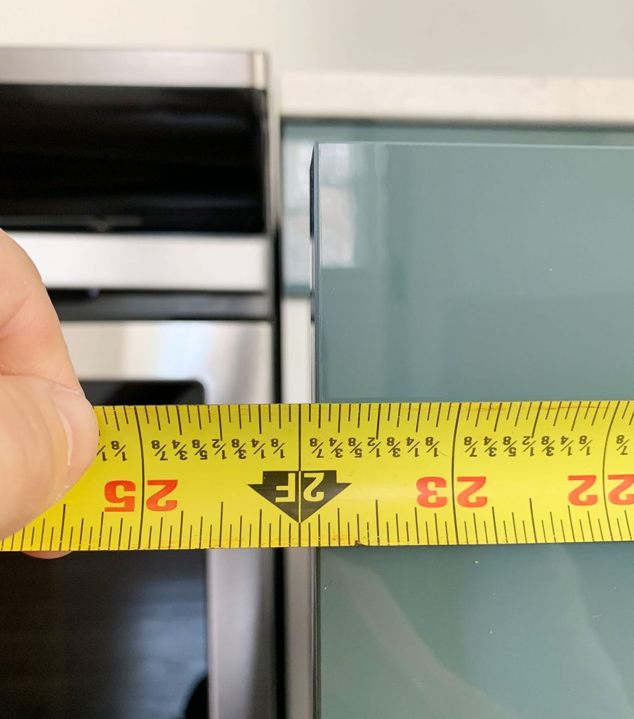 Measured Length Of Cabinet Drawer Front Using Tape Measure