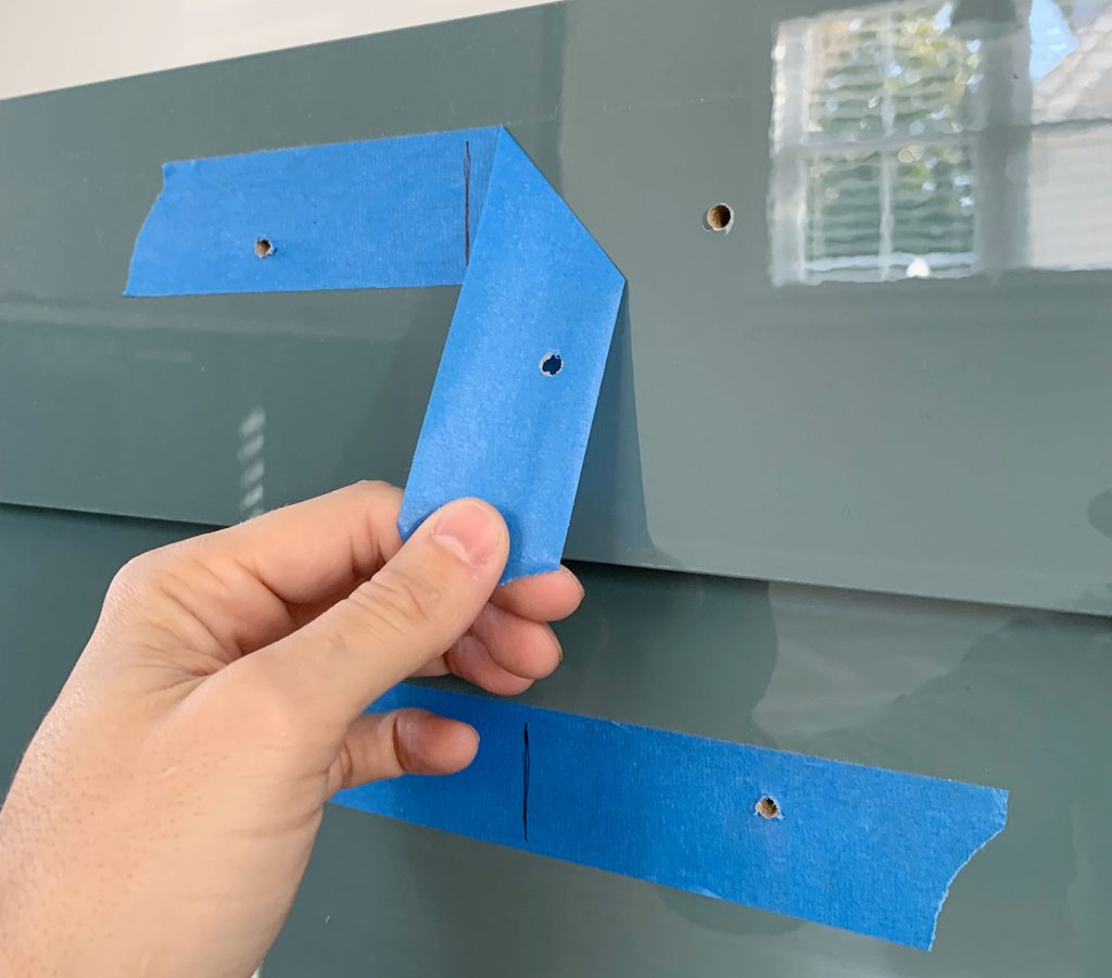 Peeling Protective Blue Tape Off Of Cabinet Drawer Front