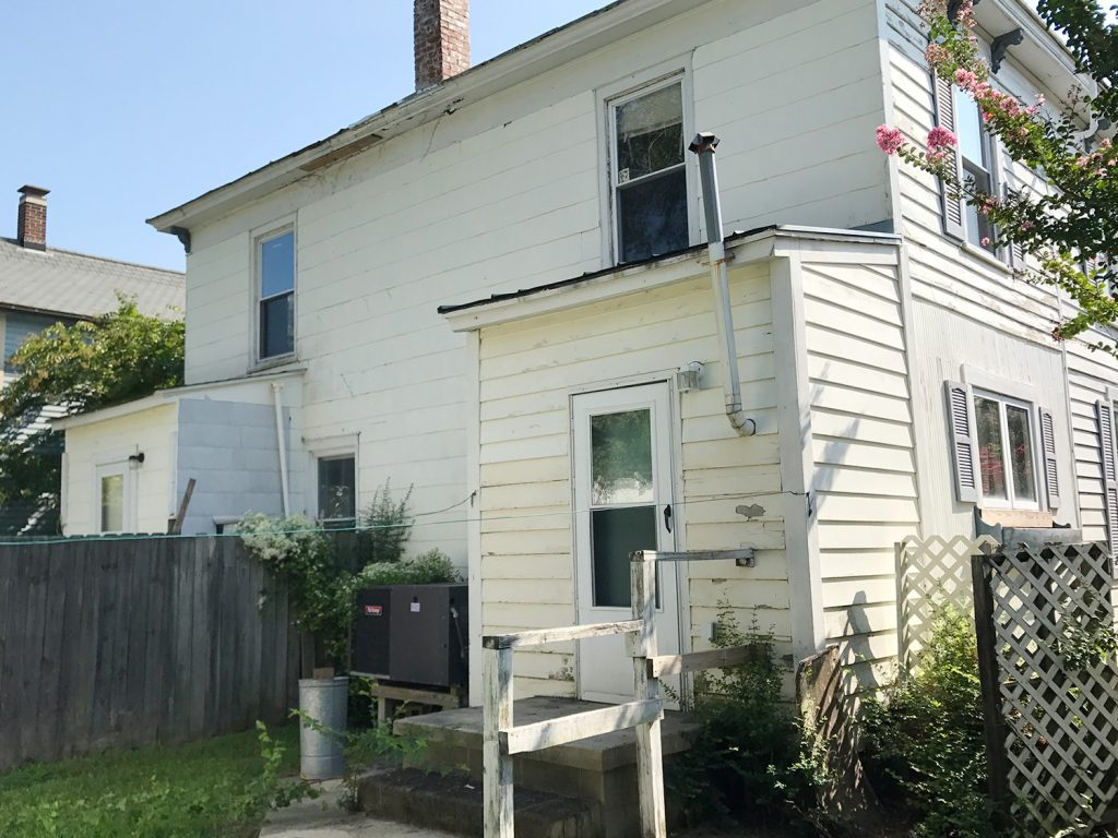 This image has an empty alt attribute; its file name is Duplex-Rear-Exterior-Before-South-Side-1024x768.jpg