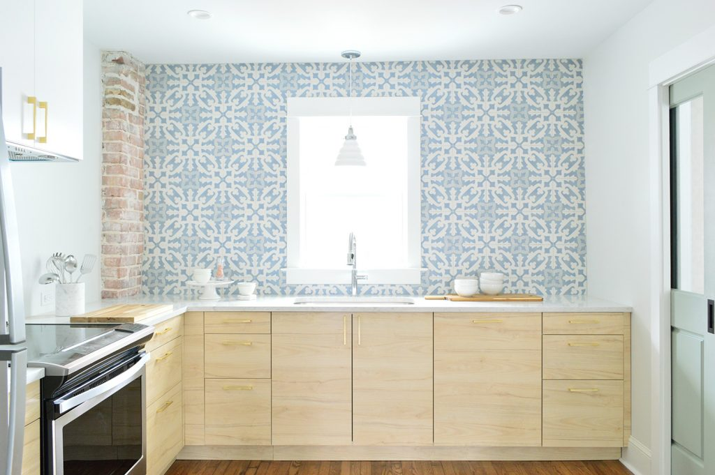 Wood Ikea Kitchen With Exposed Brick Chimney and Blue White Patterned Tile