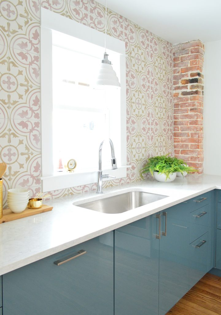 Pink Patterned Tile In Blue Kitchen With Exposed Brick Chimney