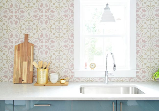 Pink Patterned Tile Backsplash With White Counters