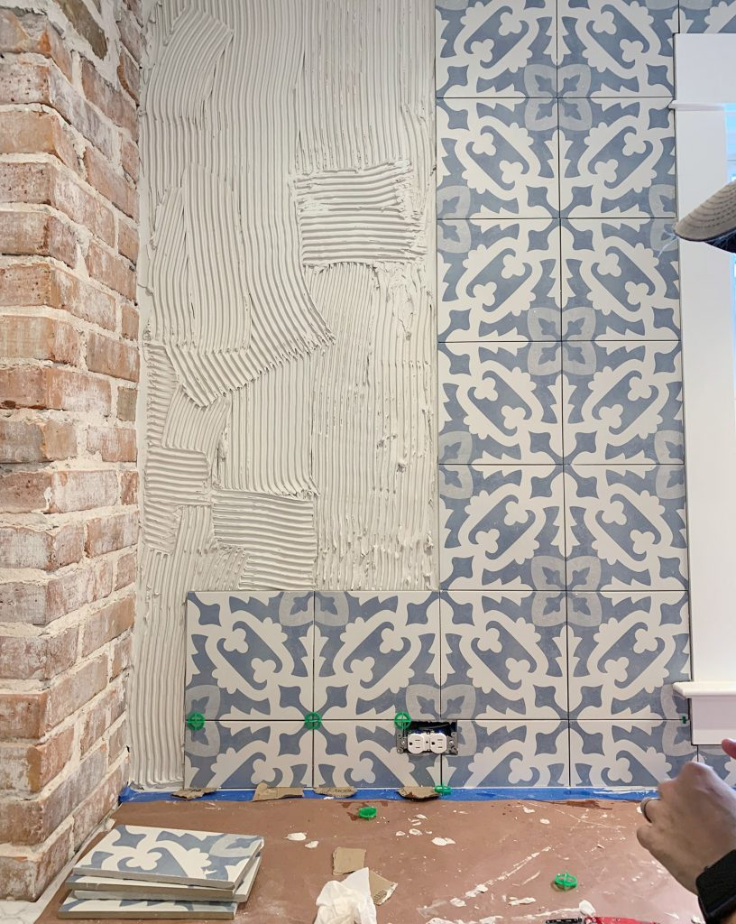 Detail Of Backsplash Installation Progress With Blue Patterned Tile