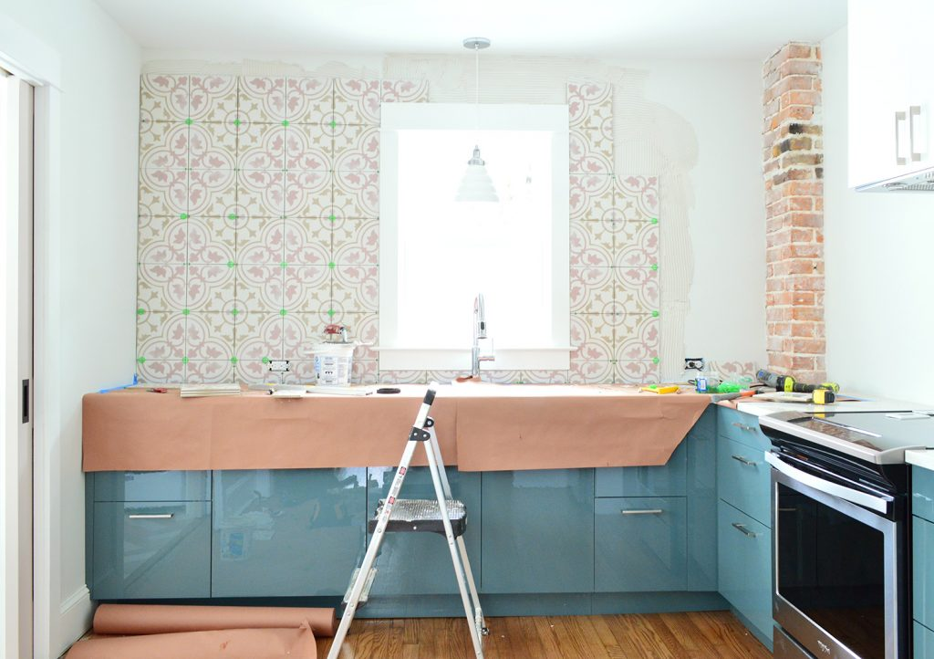Pink Patterned Backsplash Tile In Blue Kitchen Mostly Completed
