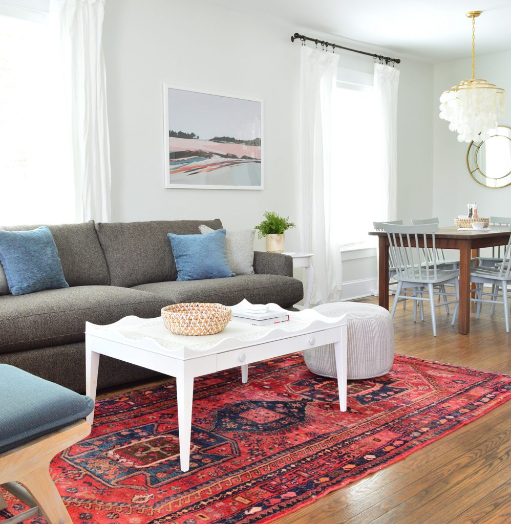Scallop Coffee Table On Red Rug With Crate And Barrel Sofa