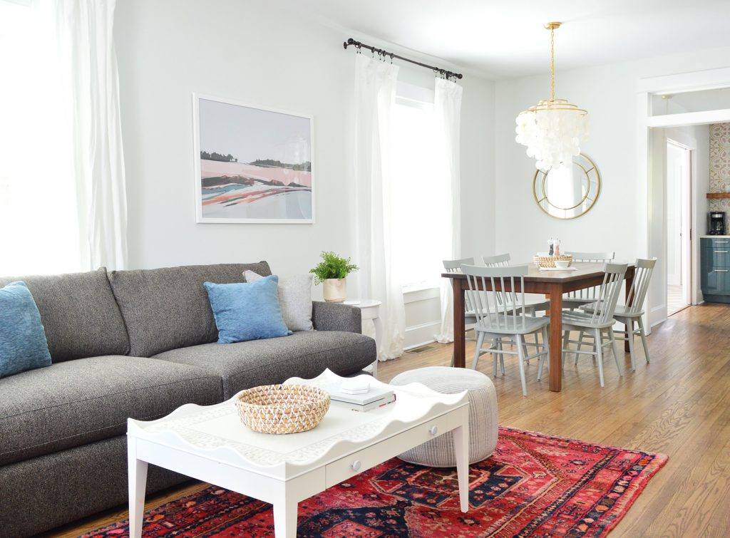 Open Living Dining And Kitchen With Crate And Barrel Sofa And Scallop Coffee Table