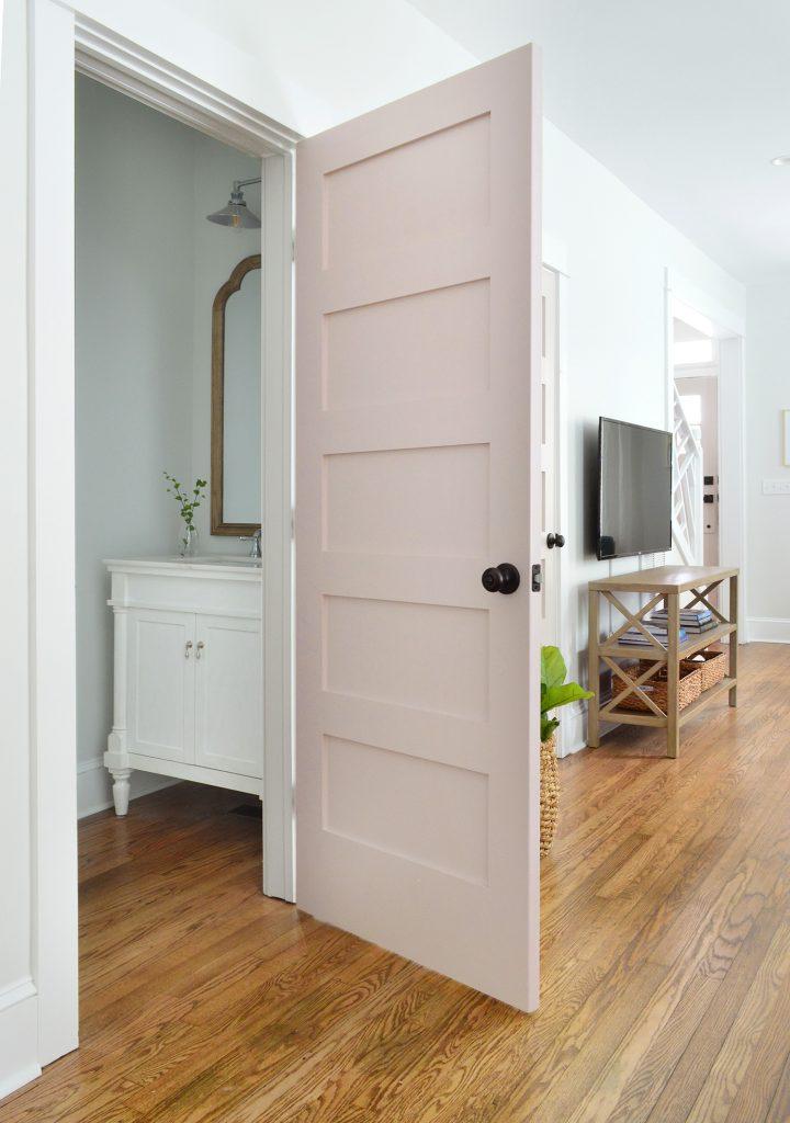 First Floor Powder Room With Pink Door