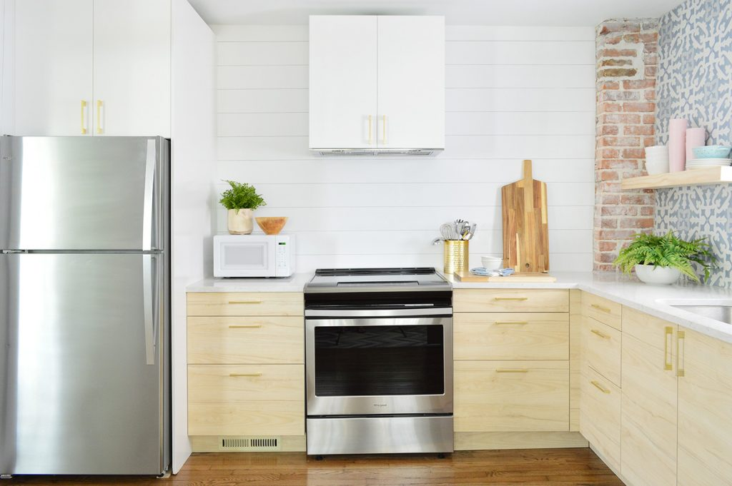 White Planked Wall In Duplex Kitchen With Wood Shelves