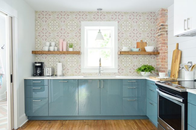 Duplex Kitchen With Blue Cabinets And Pink Patterned Backsplash