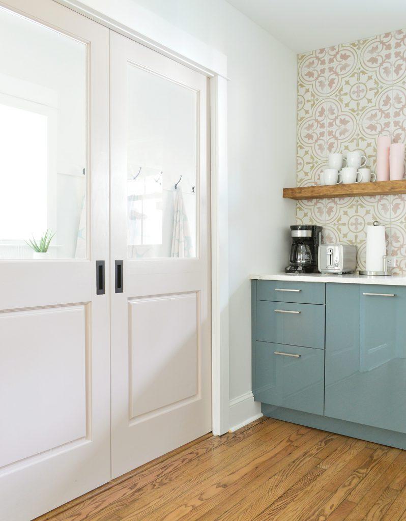 Pink Pocket Doors Between Duplex Kitchen And Mudroom