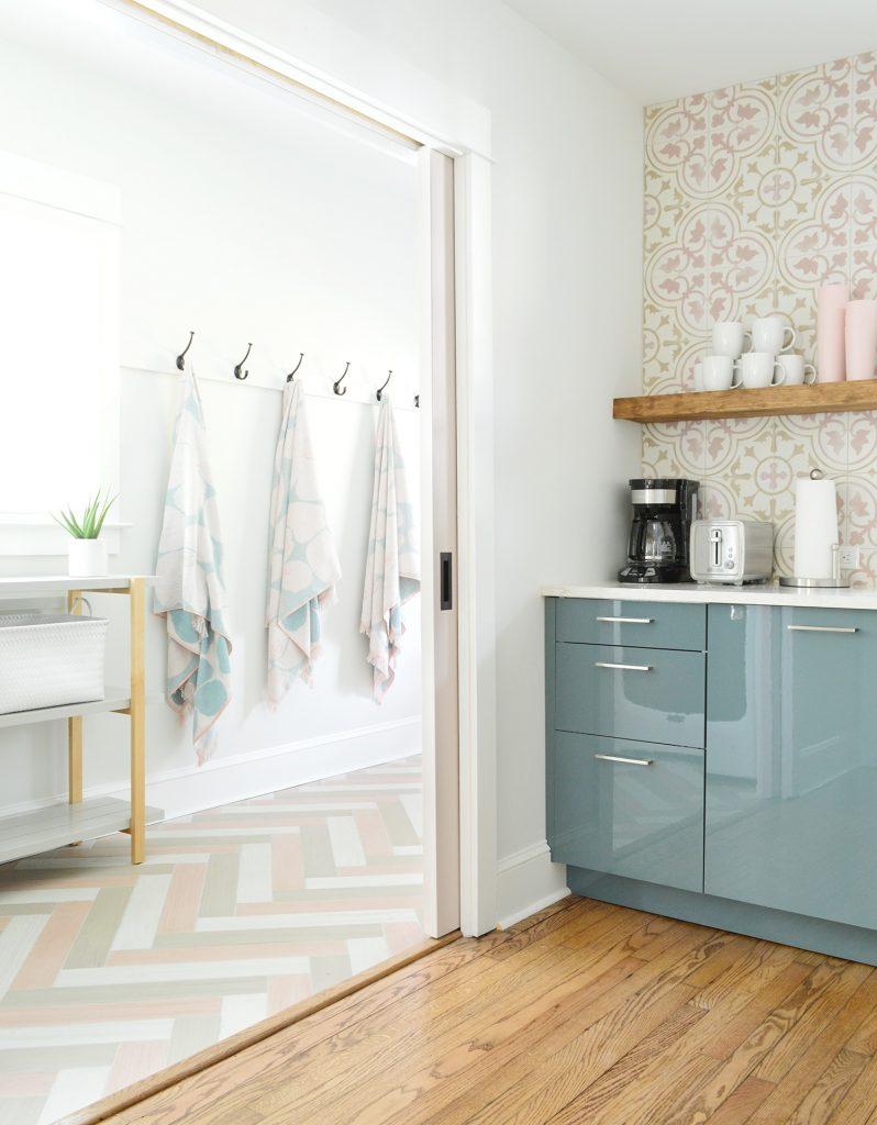 Hangin Towels Seen Through Kitchen Pocket Doors Into Mudroom