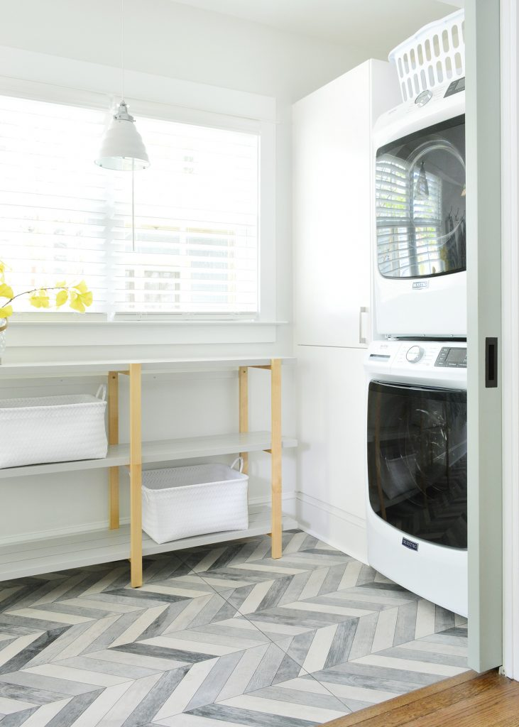 Duplex Laundry Room With Open Shelf And Stacked Laundry