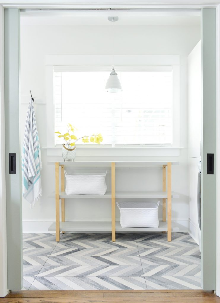 Open Shelf Through Pocket Doors In Duplex Mudroom Laundry