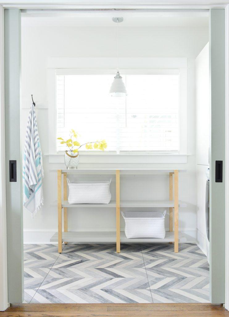 Open Shelf Through Pocket Doors In Duplex Mudroom Laundry
