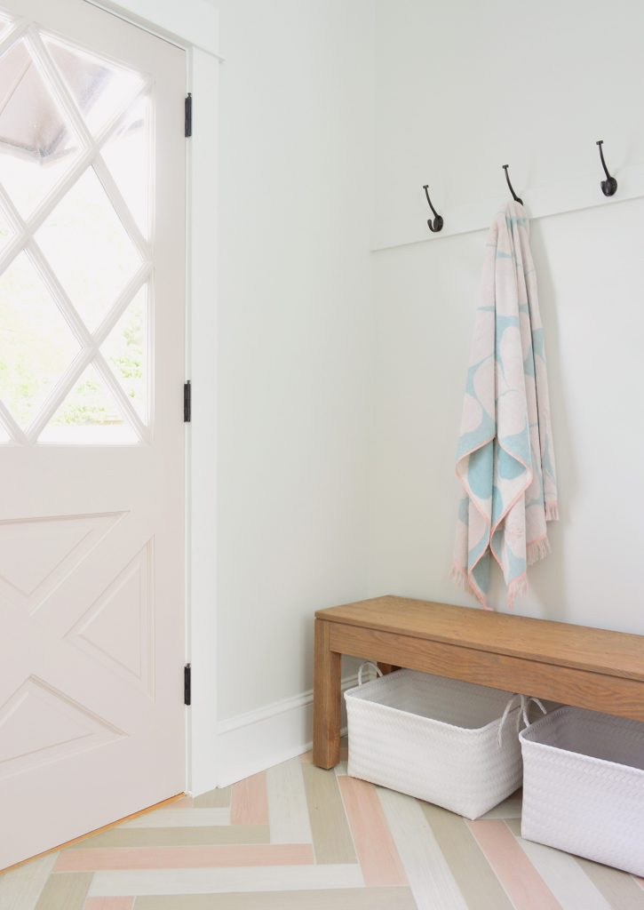Towel Hook Rail With Pink Diamond Door In Duplex Mudroom With Bench