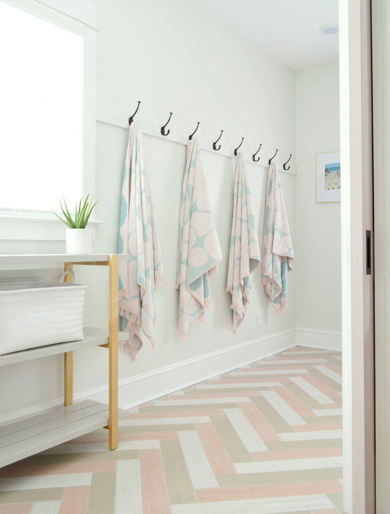 Hanging Towel Hook Storage In Duplex Mudroom With Herringbone Tile Floors