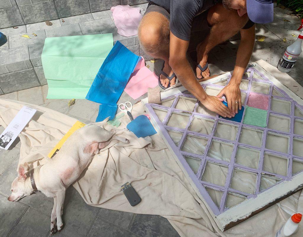 John Testing Tissue Paper Colors On Diamond Glass Window