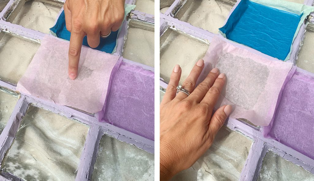 Pressing Sheet Of Pink Tissue Paper Onto Glass Pane
