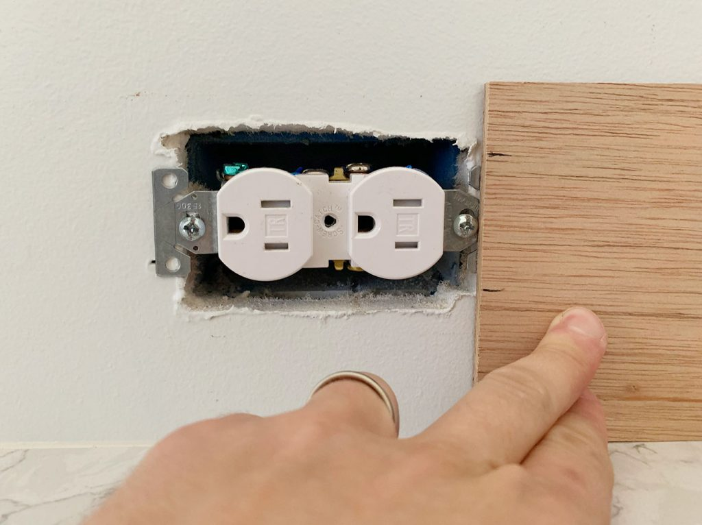 Height Of Electrical Outlet Marked Using Scrap Wood Panel