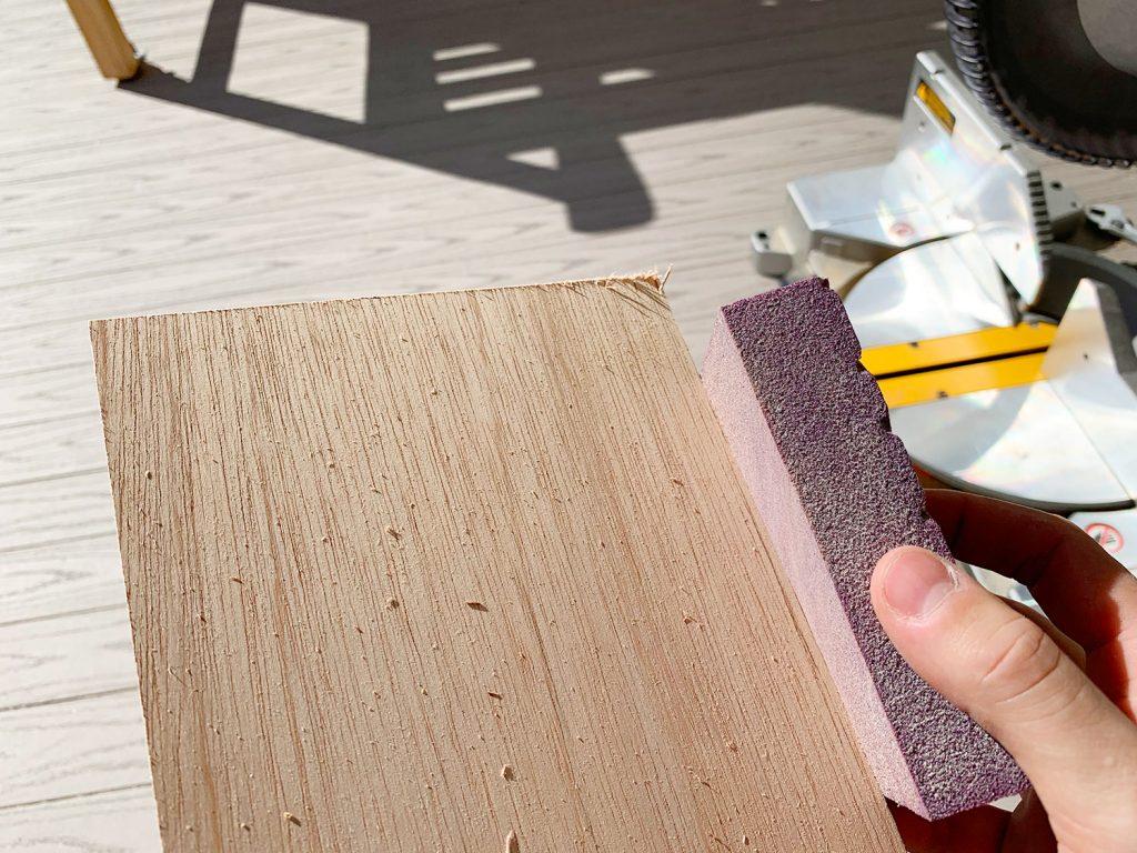 Sanding Rough Edges Of Wood Panel Strip Using Sanding Block