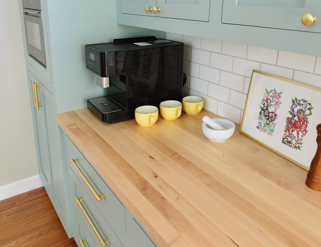 Butcher Block Countertop With Subway Tile Backsplash in Halcyon Green Blue Kitchen