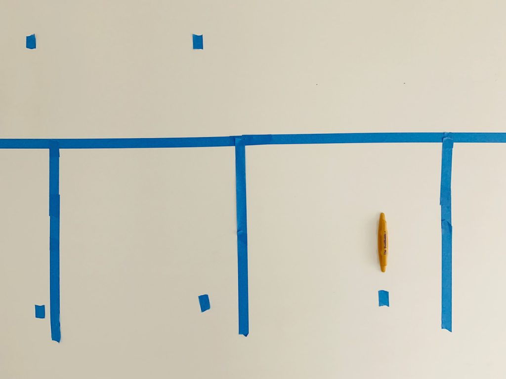 Marking Studs With Blue Painters Tape Using Stud Buddy Tool
