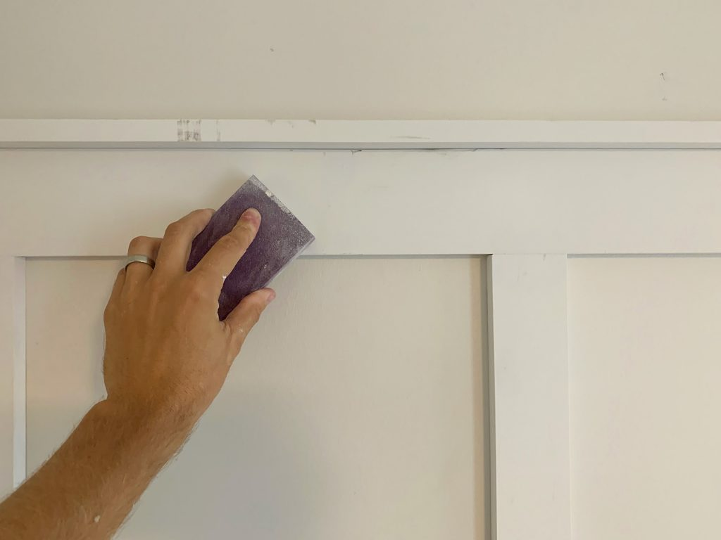 Sanding Block Being Used to Smooth Filled Holes On Board And Batten