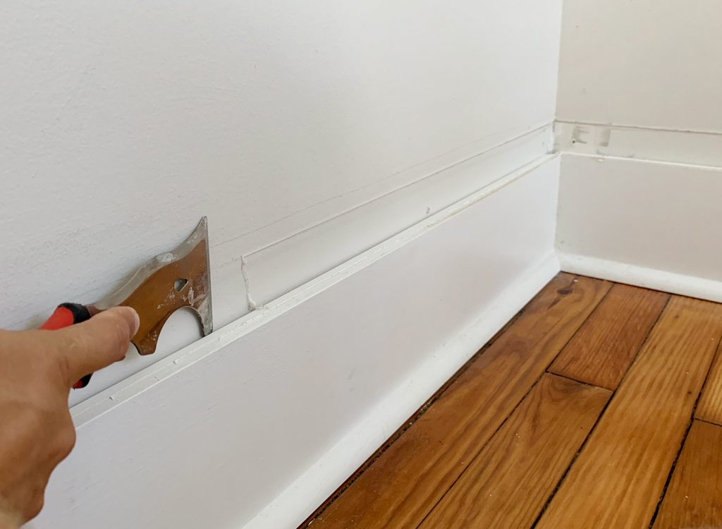 Scraping Old Caulk For Smooth Wall Above Baseboard