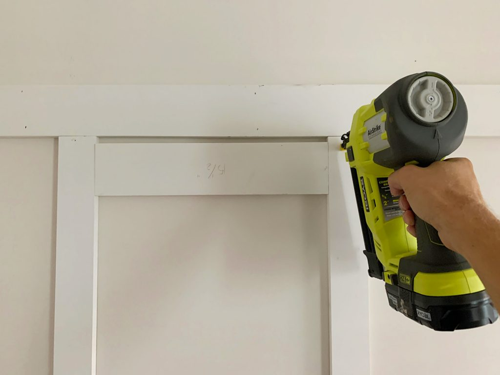 Installing Vertical Battens Using Nail Gun And Wood Spacer