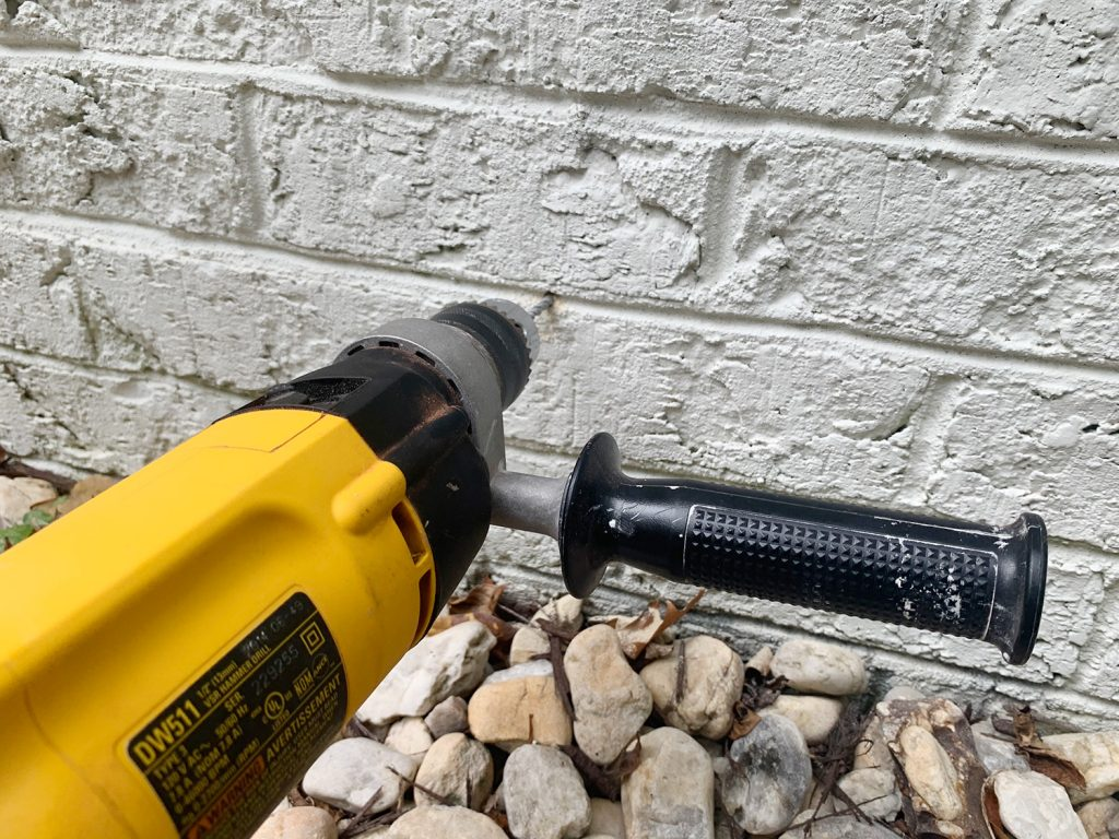 Hammer Drilling Making Hole In Brick Wall