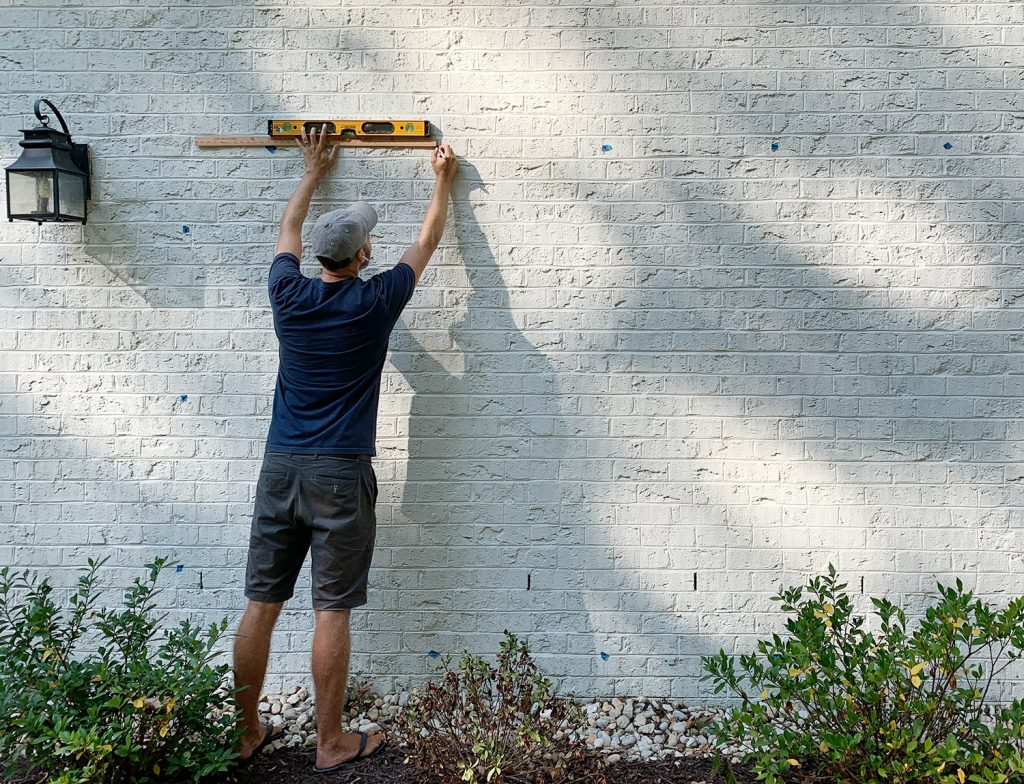 John Marking Trellis Hooks On Brick Wall