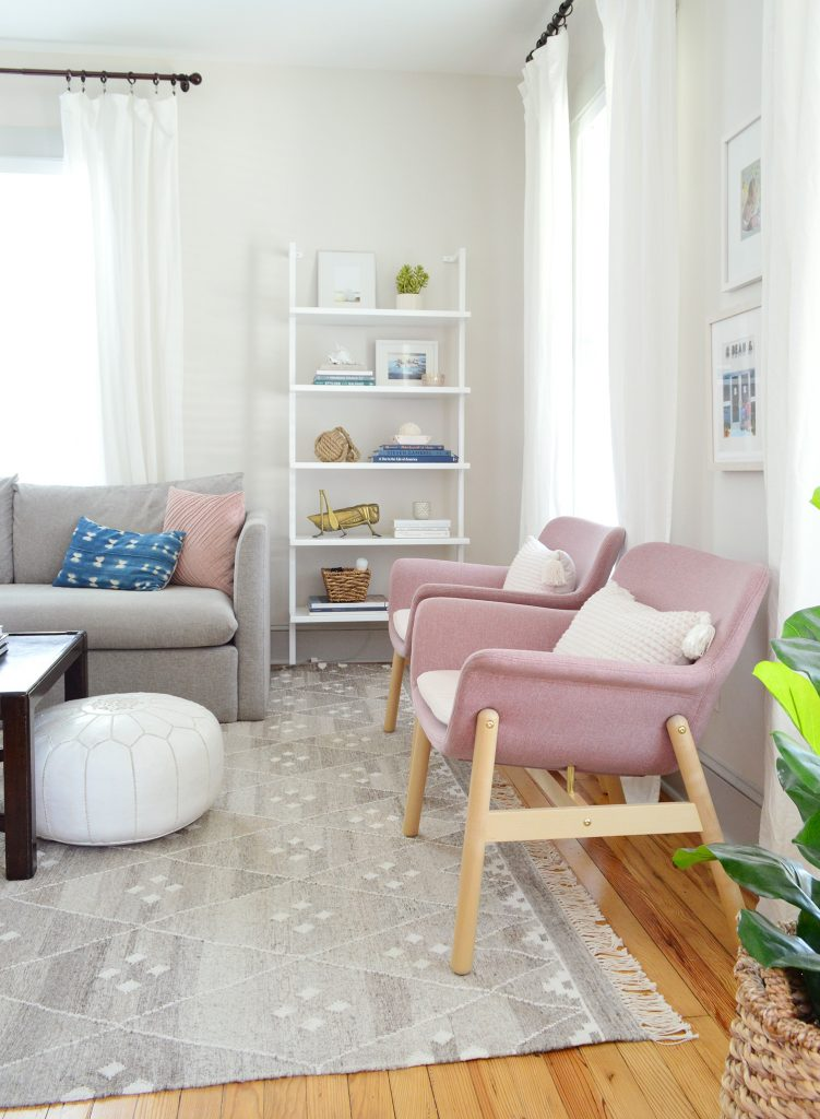 Pink Ikea Chairs And Open Bookcase In Beach House Living Room