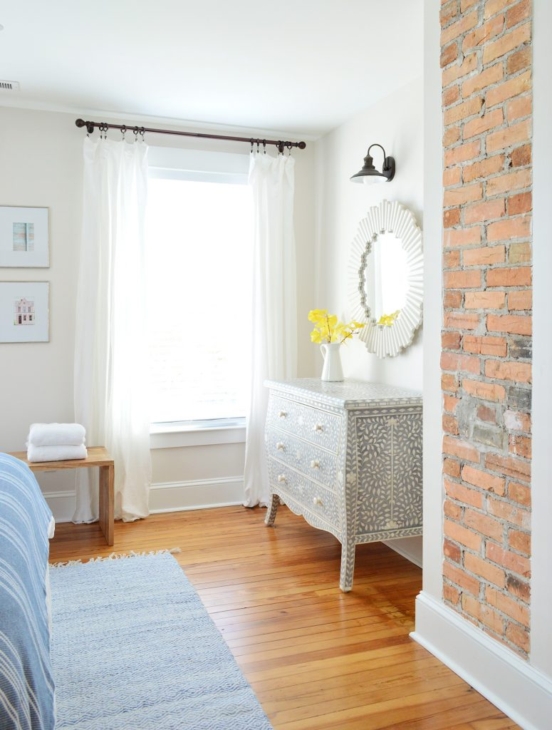 Exposed Brick Fireplace In Beach House Front Bedroom And Inlay Dresser