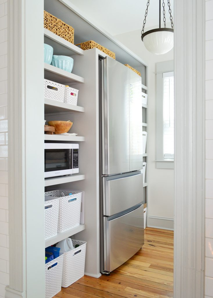 Walk In Beach House Pantry With More Baskets On Shelves