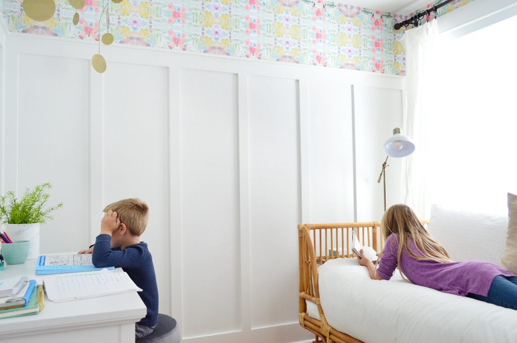 Kids Lounging In Bedroom With Board And Batten And Wallpaper