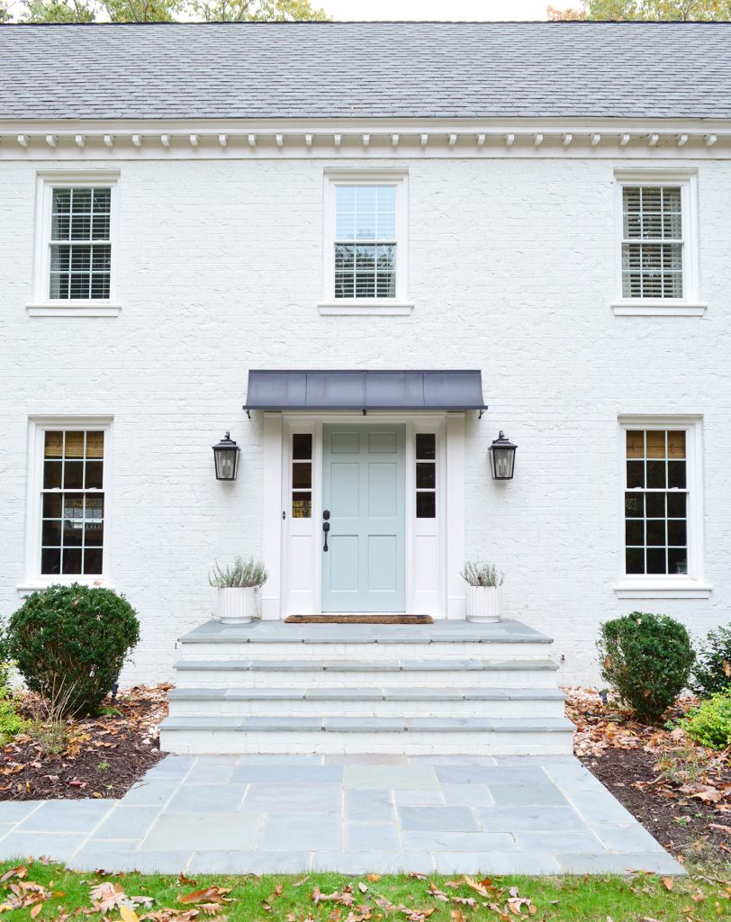 This image has an empty alt attribute; its file name is White-Brick-Exterior-Fall-Path-Straight-Porch-Detail-812x1024.jpg