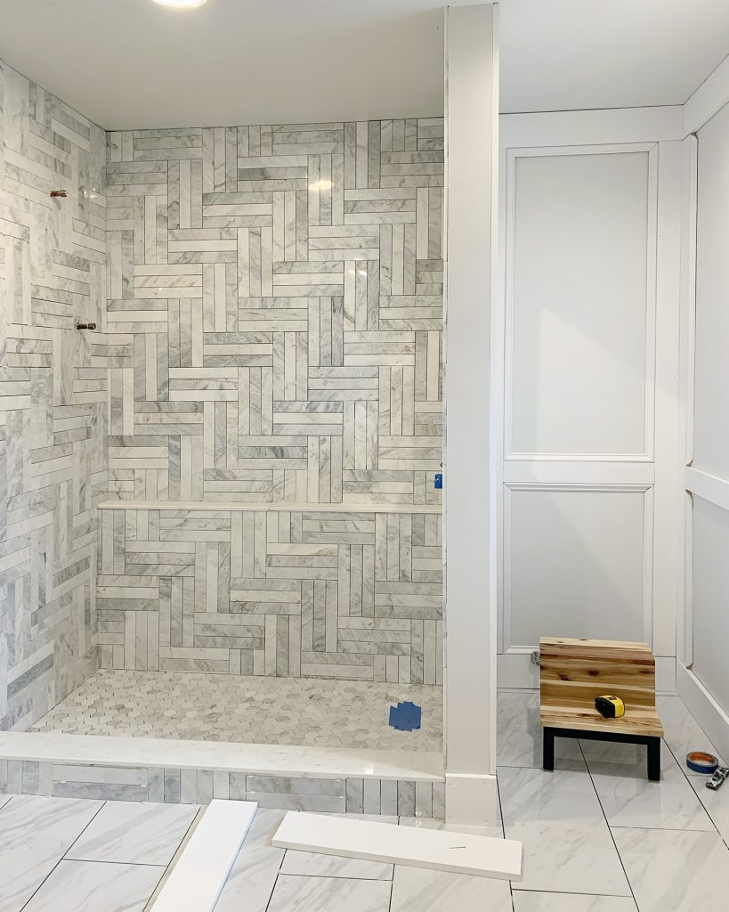 Unpainted Box Panel Molding In Master Bathroom With Tiled Marble Shower