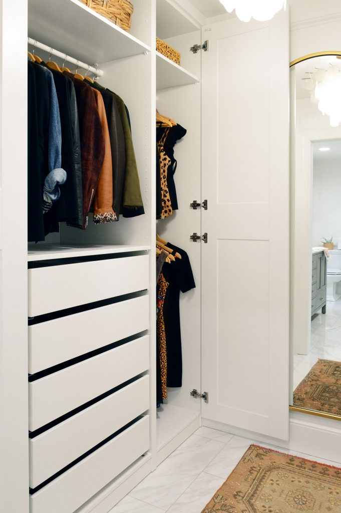 White Ikea Pax Closet With Three Hanging Bars And Drawers