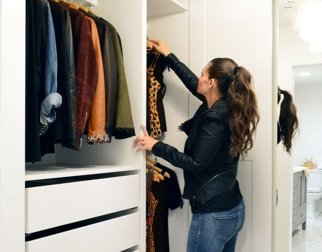 Sherry Getting Cloths From Hanging Bar In Ikea Pax Closet Remodel