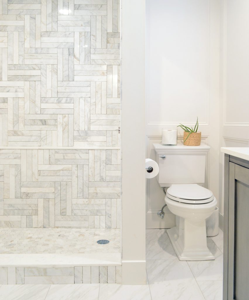 Master Bathroom Update With Toilet Installed With Ungrouted Marble Shower