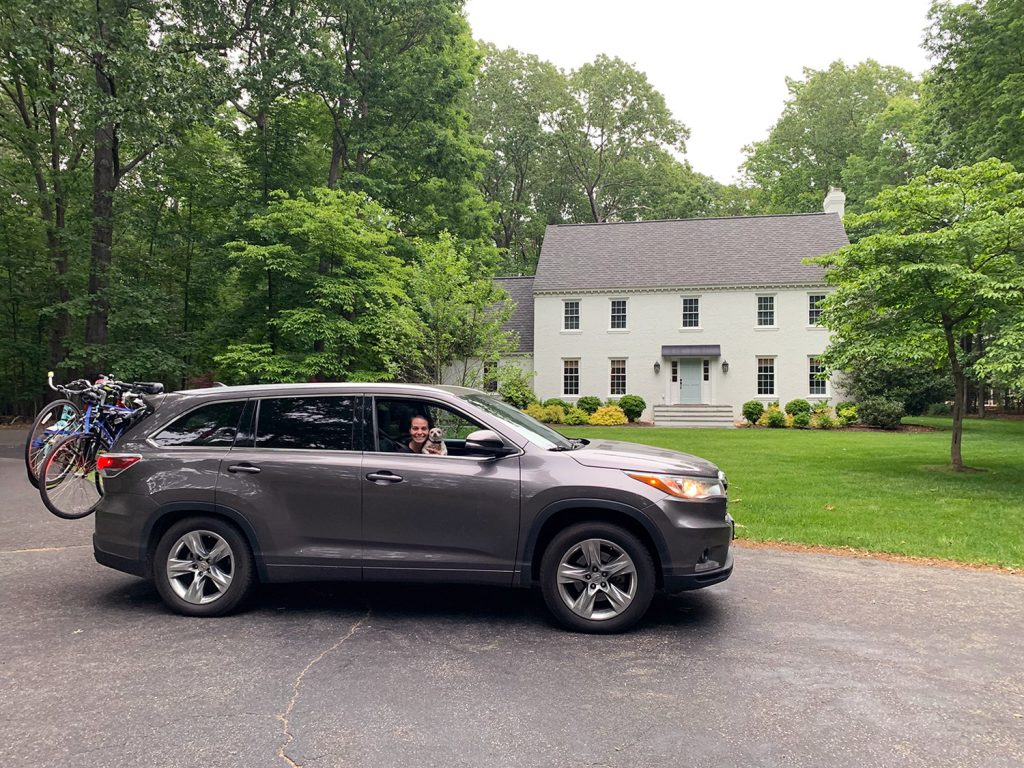 Toyota Highlander car parked in front of white brick house
